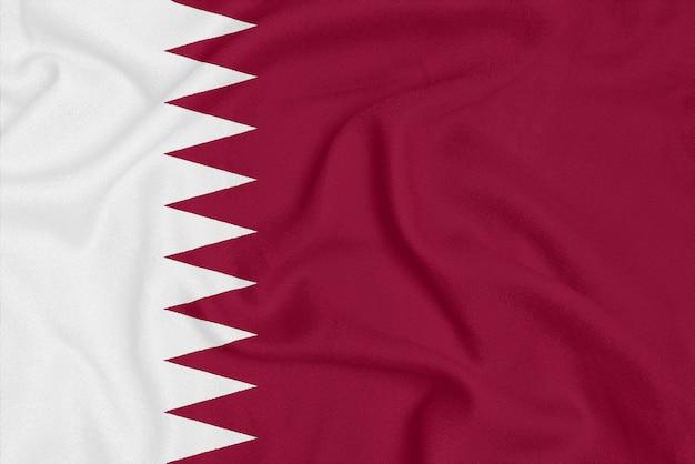 テクスチャ生地にカタールの旗。