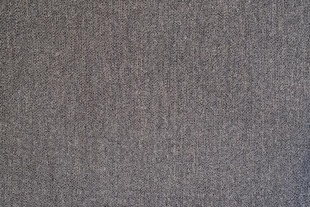 Серая шерстяная текстура ткани. кашемир. твердый бесшовный фон.