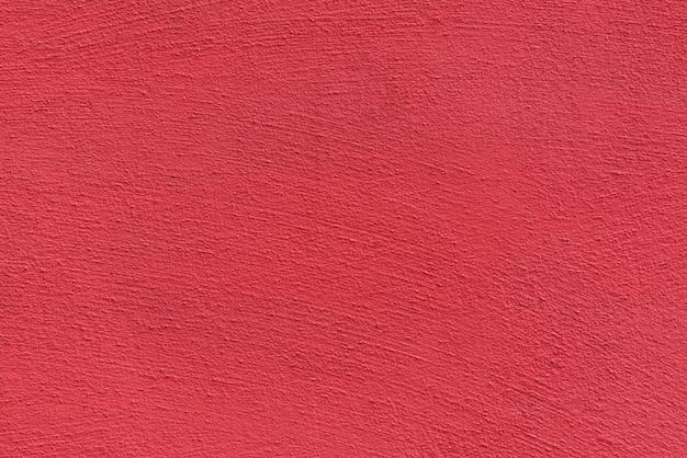 明るい粗い漆喰表面。生きているサンゴ色。背景とテクスチャ