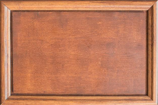 Деревянная табличка с рамой.