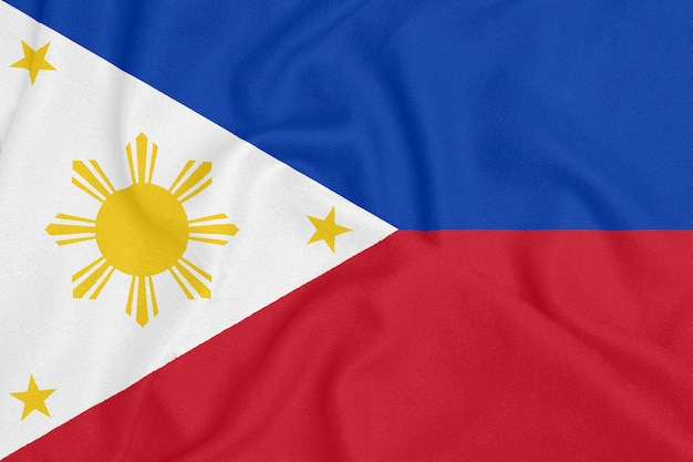 Флаг филиппин на фактурной ткани. патриотический символ
