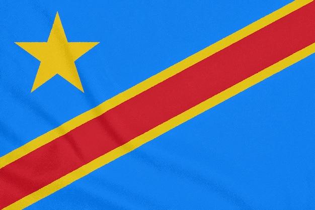 テクスチャ生地のコンゴ民主共和国の旗。愛国心が強いシンボル