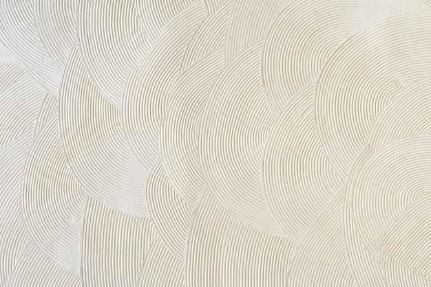 Круглые узоры на белой штукатурке. абстрактная текстура