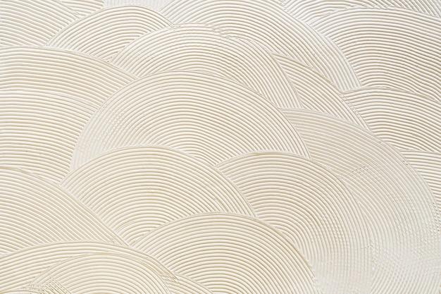 白い漆喰の円形パターン。抽象的なテクスチャ
