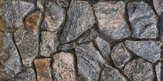 天然石の古い壁。抽象的な背景