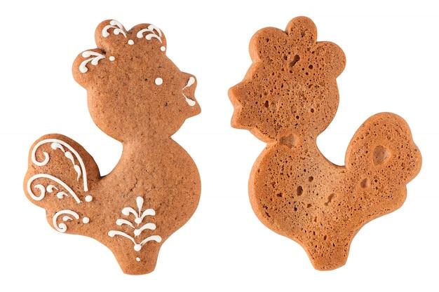 白で隔離されるジンジャーブレッドコッククッキー