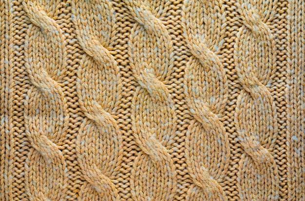 ケーブルニットパターンとニット布のテクスチャ