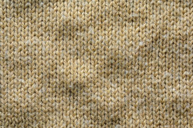 ベージュのニット織物のテクスチャ