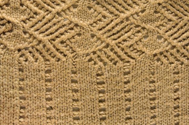 ニット繊維のベージュのテクスチャ