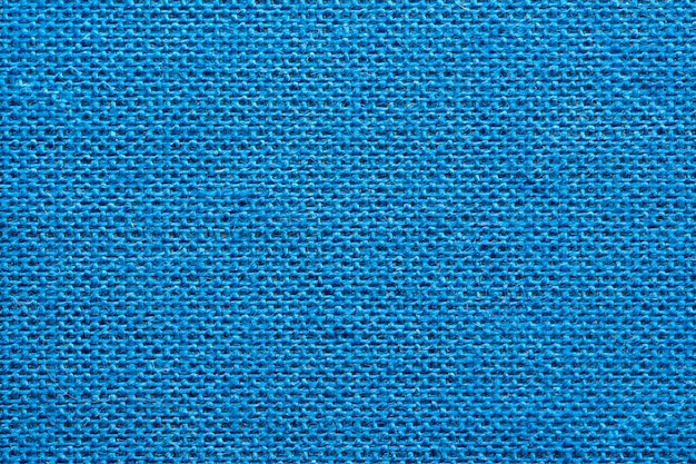 青い布の本の表紙のマクロテクスチャ