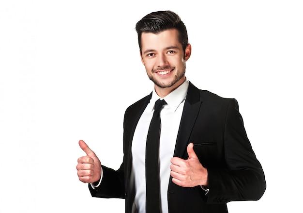 スーツの感情的な若い男