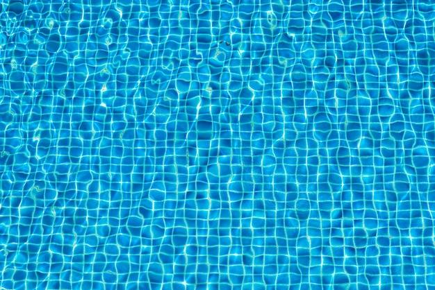 スイミングプールの抽象的な背景の水