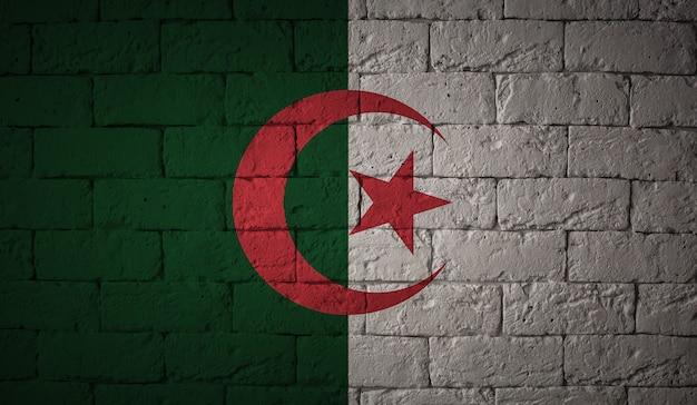 グランジ壁背景にアルジェリアの旗。元の比率