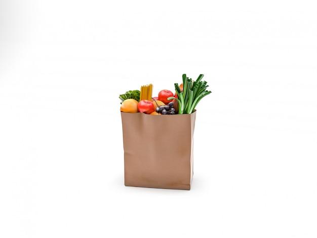 果物と緑の野菜が入った紙袋