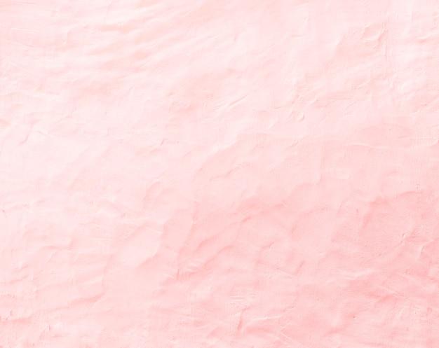 背景のための古いピンクのコンクリートの壁の質感