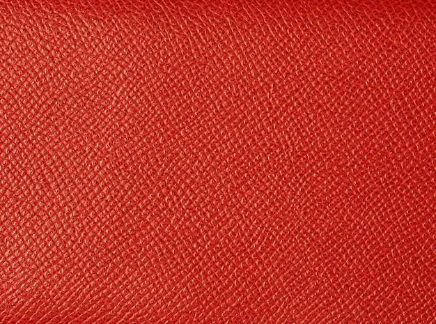 赤く塗られた自然な質感のレザー。背景およびテンプレートとして使用できます