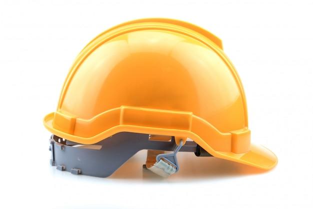 Изолированный желтый шлем для строителя