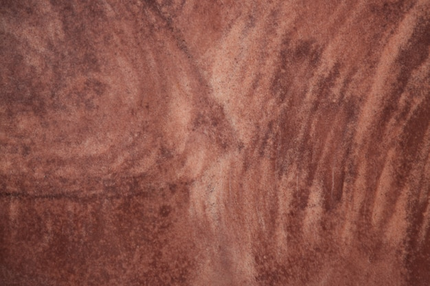 赤い石の表面のテクスチャ背景