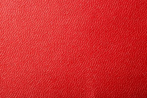 Красная текстурированная кожа фон.