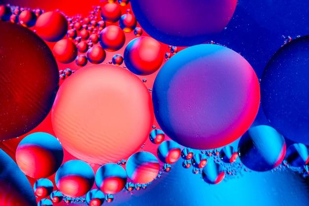 カラフルなグラデーション色と抽象的な背景。水抽象的なサイケデリックパターン画像の油滴。