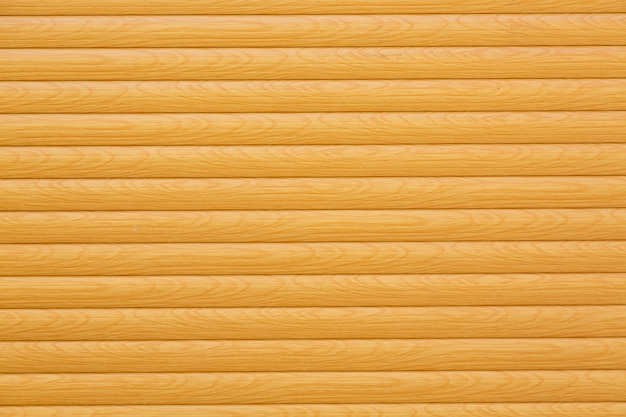 背景として黄色またはベージュに塗られた水平の木製の板