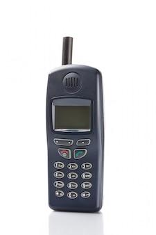 Старый мобильный телефон на белом