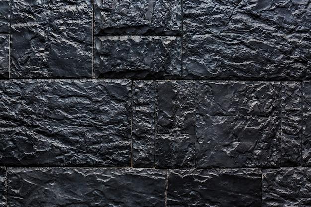 Текстура черной каменной стеной для фона