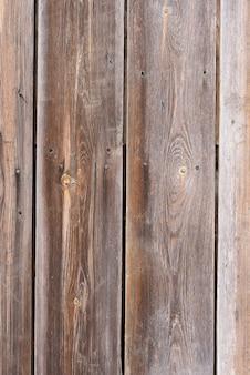 素朴な風化した納屋ウッドの背景にノット、くぎ穴