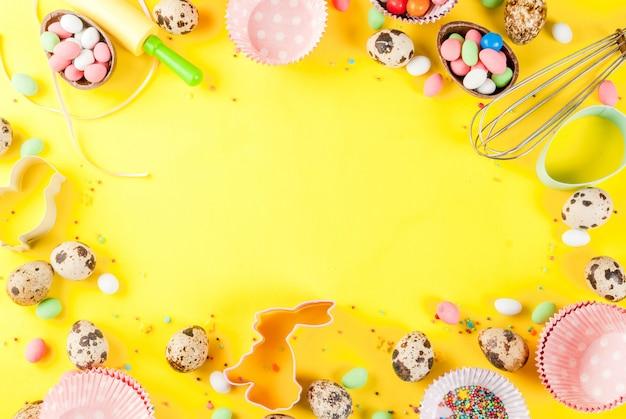 ベーキングと背景を調理イースターの甘いベーキングコンセプト-ホイップクッキーカッターウズラの卵砂糖振りかけるための麺棒で
