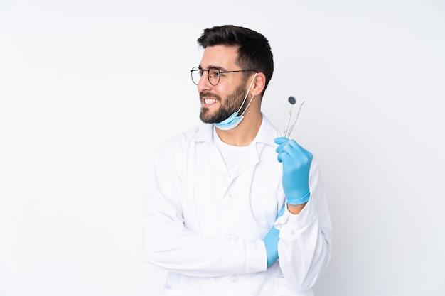 分離上のツールを保持している歯科医男
