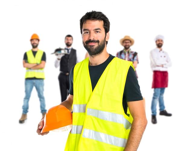白い背景の上の労働者