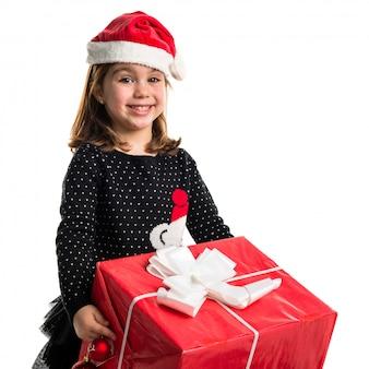 大きな赤い贈り物の子供