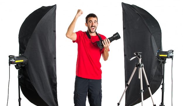 彼のスタジオの幸運な写真家