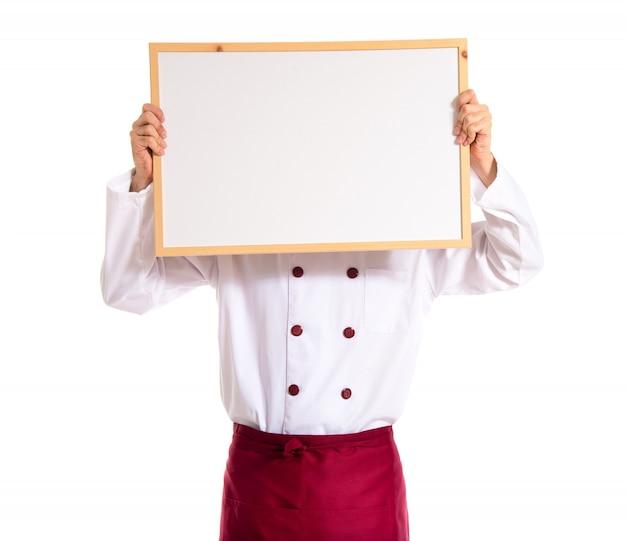 Шеф-повар, держащий пустой плакат