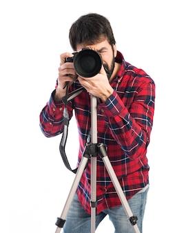 Фотограф снимает фото
