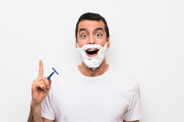 男の指を上向きのアイデアを考えて分離白上彼のひげを剃る