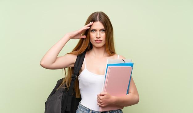 不幸な若い学生女性と何かに不満を感じています。否定的な表情