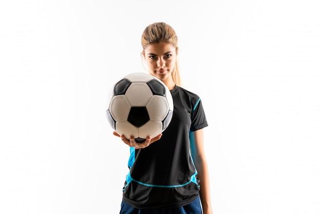 金髪のフットボール選手のティーンエイジャーの女の子