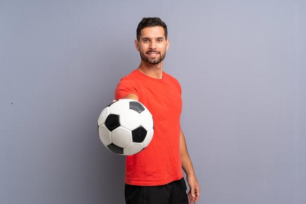 Счастливый молодой футболист человек