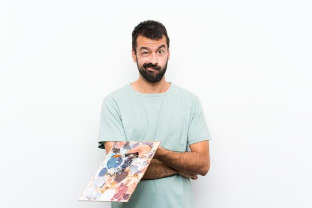 パレットを持って若いアーティスト男