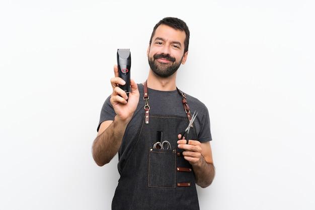 Мужской парикмахер в фартуке на белом фоне