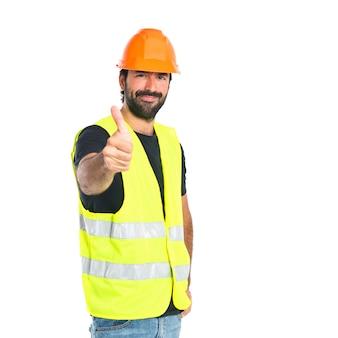 白い背景の上に親指を持つ労働者