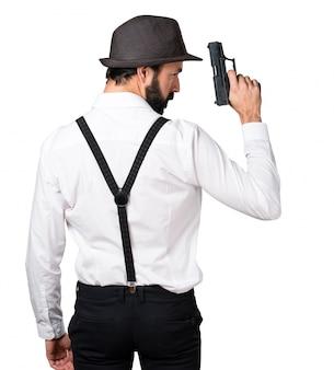 Человек-хипстер с бородой с пистолетом