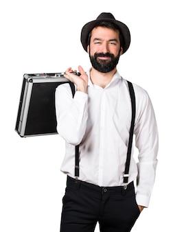 Человек-хипстер с бородой, держащий портфель