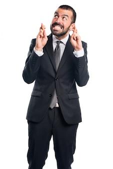彼の指の交差点でビジネスマン