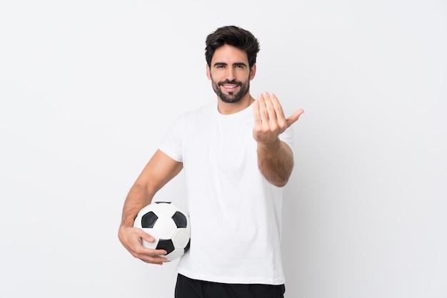 Молодой красавец с бородой на белом фоне с футбольным мячом