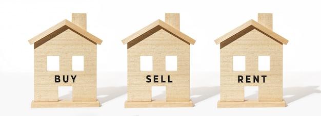 白い背景の木造住宅モデルのグループ。購入、販売、レンタルのコンセプト