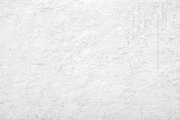 白いコンクリート背景テクスチャ。粗い白塗りの壁の背景。大まかなテクスチャの構築