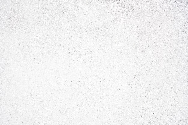 白いコンクリートの背景。粗い白塗りの壁の背景。大まかなテクスチャの構築
