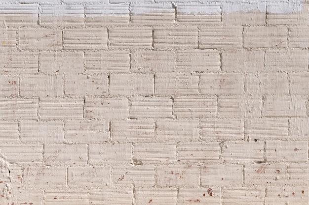 塗られたレンガ壁の背景